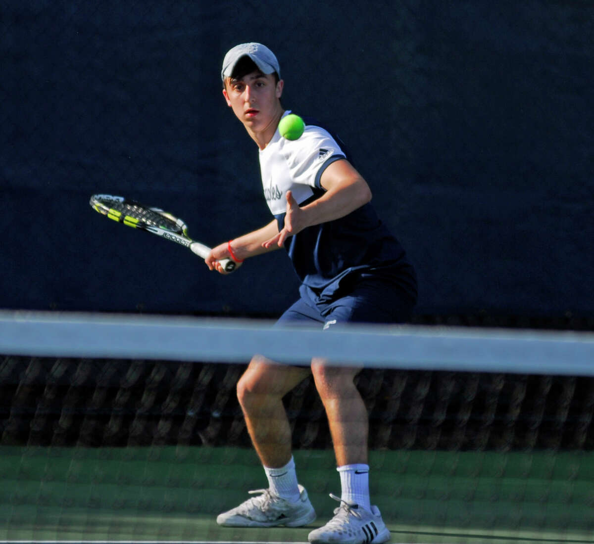 Staples' Max Zimmerman returns a shot during a boys tennis match against Greenwich on Monday, April 18th, 2016.