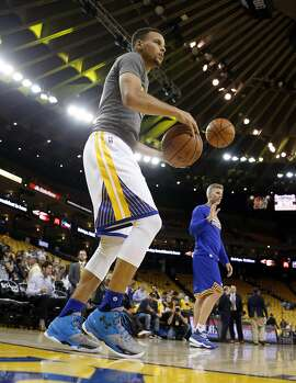 Golden State Warriors' Stephen Curry tests his injured ankle before Warriors play Houston Rockets in Game 2 of 1st round of NBA Playoffs at Oracle Arena in Oakland, Calif., on Monday, April 18, 2016.