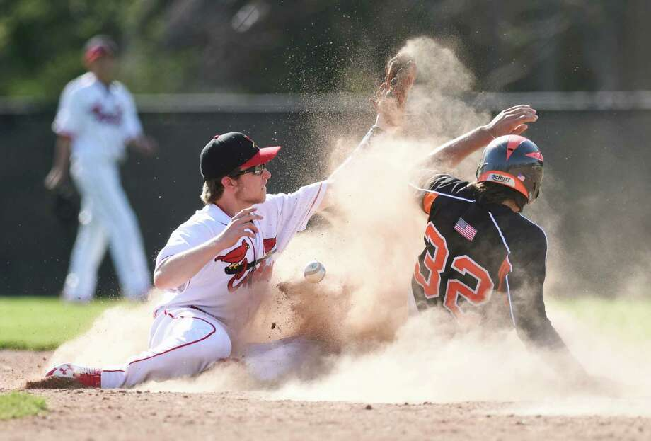 Greenwich second baseman Daniel Combs, left attempts to tag out Ridgefield baserunner Armand Fabbri to no avail as the ball slips from his glove in Ridgefield's 12-5 win over Greenwich in the high school baseball game at Greenwich High School in Greenwich, Conn. Monday, April 18, 2016. Photo: Tyler Sizemore / Hearst Connecticut Media / Greenwich Time