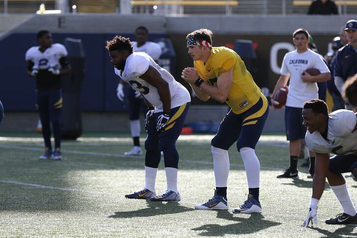 Zach Kline works through a drill at Cal practice this month.