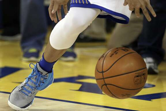 Golden State Warriors' Stephen Curry practices prior to Game 2 of a first-round NBA basketball playoff series against the Houston Rockets on Monday, April 18, 2016, in Oakland, Calif. Curry rolled his right ankle in Game 1 and is questionable for play tonight. (AP Photo/Ben Margot)