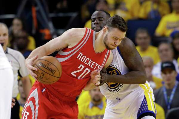 The Rockets feel Donat- as Motiejunas can make Draymond Green, right, work harder on defense.