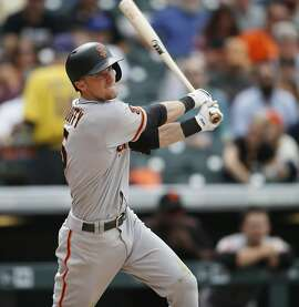 San Francisco Giants' Matt Duffy watches his RBI double off Colorado Rockies starting pitcher Jorge De La Rosa during the seventh inning of a baseball game Thursday, April 14, 2016, in Denver. Colorado won 11-6. (AP Photo/David Zalubowski)