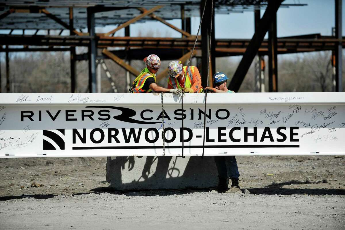 Workers with Midwest Steel out of Ballston Spa, install the final 60-foot steel beam at the Rivers Casino & Resort on Monday, April 18, 2016, in Schenectady, N.Y. (Paul Buckowski / Times Union)