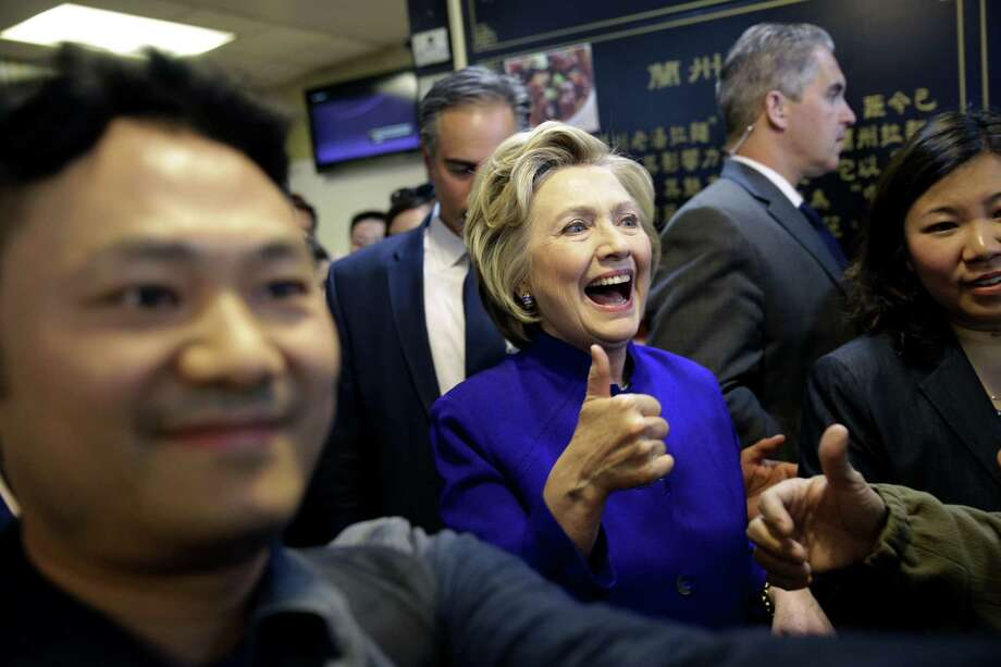 Democratic presidential candidate Hillary Clinton talks with patrons at a restaurant in the Flushing section of Queens in New York, Monday, April 18, 2016. (AP Photo/Seth Wenig) ORG XMIT: NYSW111 Photo: Seth Wenig / AP