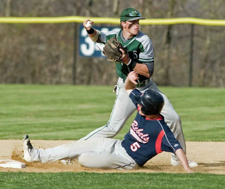 New Milford's Jackson Olson fires the ball to first trying for the double play as New Fairfield's Tyler Hart slides into second on Monday. Photo: Scott Mullin / For Hearst Connecticut Media / The News-Times Freelance