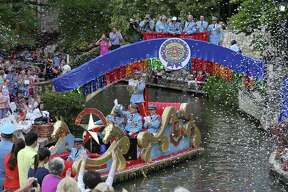 "King Antonio XCIV R. Hunt Winton III enters the Arneson River Theatre at La Villita during the 2016 Texas Cavaliers River Parade ""River of Champions"" April 18, 2016."