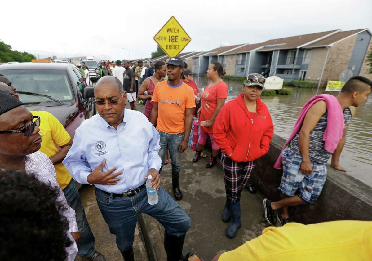 Texas Senator Rodney Ellis talks with people on Greens Rd. during the evacuations at Arbor Court Apartments in the Greenspoint area Monday, April 18, 2016, in Houston.