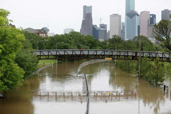 Memorial Drive at Studemont flooded by the over flowing Buffalo Bayou, Monday, April 18, 2016, in Houston.