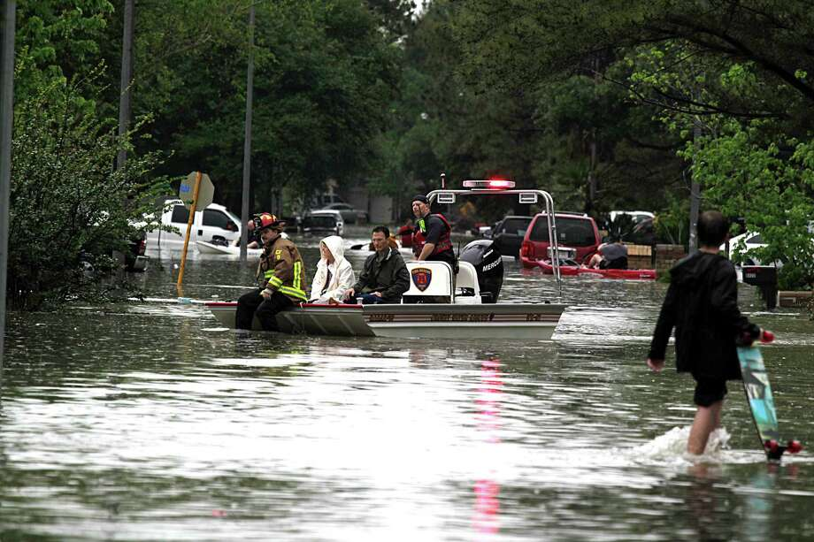 A water rescue boat from the Crosby Volunteer Fire Department delivers people to high ground in the Bear Creek Village subdivision after flooding from heavy rain Monday, April 18, 2016, in Houston. Photo: James Nielsen, Houston Chronicle / © 2016  Houston Chronicle