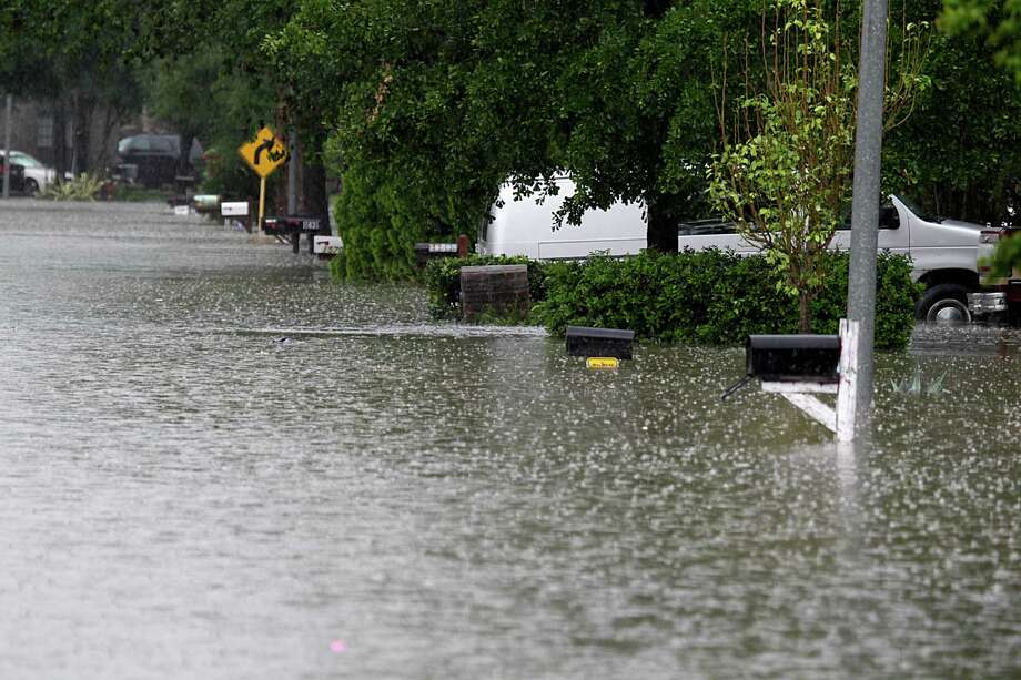 Flood waters nearly top mailboxes in Bear Creek Village during the Tax Day Flood. Photo: James Nielsen, Houston Chronicle / © 2016  Houston Chronicle