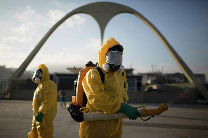 FILE - In this Tuesday, Jan. 26, 2016 file photo, a health workers stands in the Sambadrome spraying insecticide to combat the Aedes aegypti mosquito that transmits the Zika virus in Rio de Janeiro, Brazil. In the 1940s and 1950s, Brazilian authorities made such a ferocious assault on Aedes aegypti that the mosquito, that it was eradicated from Latin America's largest country by 1958. But eradication experts say there is little chance that Brazil can come anywhere near stamping out the pest like it did a half century ago.