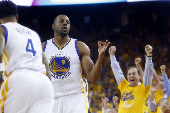 Golden State Warriors' Andre Iguodala reacts to his 3-pointer as co-owner Joe Lacob celebrates in 1st quarter against Houston Rockets in Game 2 of 1st round of NBA Playoffs at Oracle Arena in Oakland, Calif., on Monday, April 18, 2016.