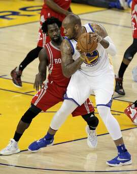 Patrick Beverley (2) defends against Marreese Speights (5) in the first half as the Golden State Warriors played the Houston Rockets in game 2 of the first round of the Western Conference Playoffs at Oracle Arena in Oakland, Calif., on Monday, April 18, 2016.