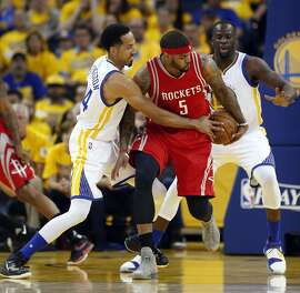 Golden State Warriors' Shaun Livingston guards Houston Rockets' Josh Smith in 1st quarter in Game 2 of 1st round of NBA Playoffs at Oracle Arena in Oakland, Calif., on Monday, April 18, 2016.