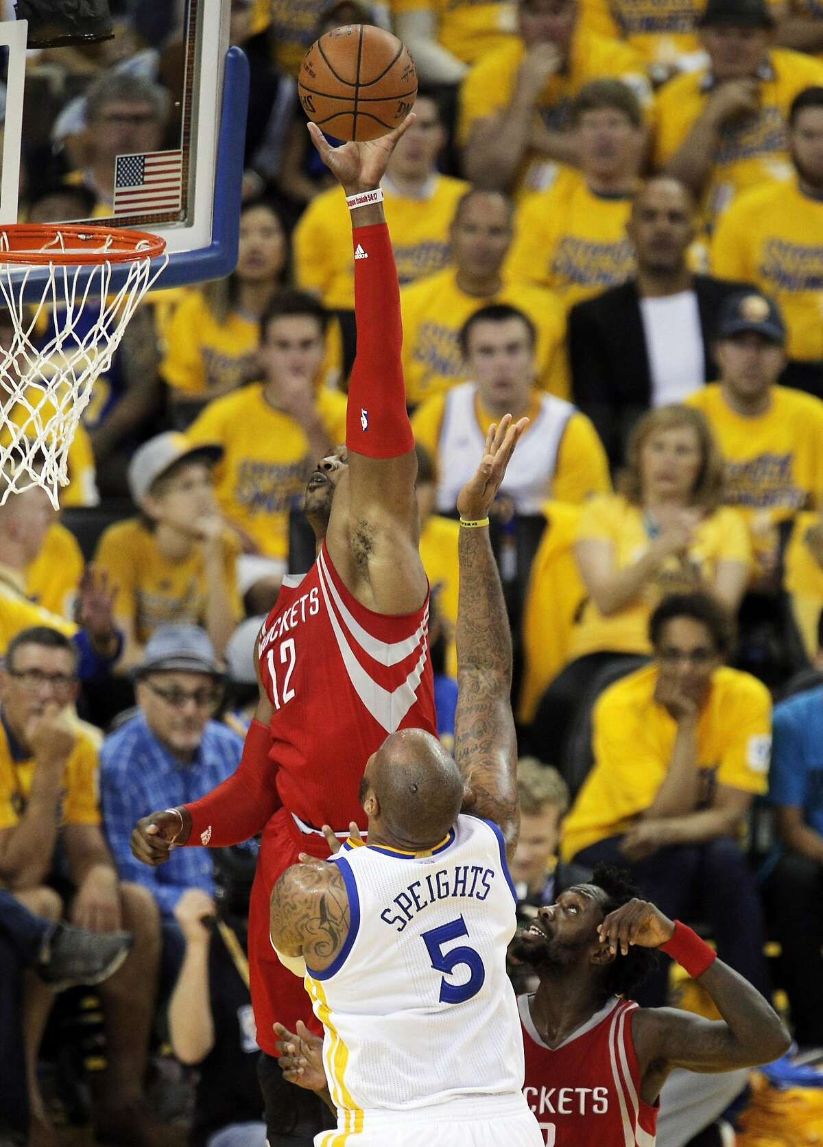 Dwight Howard (12) bats away a shot by Marreese Speights (5) but the basket was called good in the first half as the Golden State Warriors played the Houston Rockets in game 2 of the first round of the Western Conference Playoffs at Oracle Arena in Oakland, Calif., on Monday, April 18, 2016.