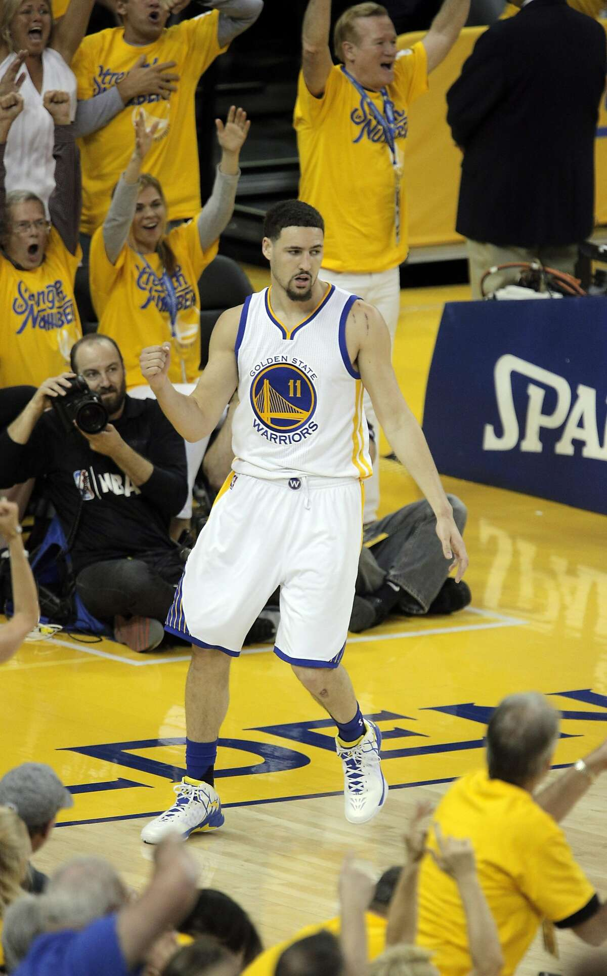 Klay Thompson (11) reacts to foul call on a made basket in the first half as the Golden State Warriors played the Houston Rockets in game 2 of the first round of the Western Conference Playoffs at Oracle Arena in Oakland, Calif., on Monday, April 18, 2016.