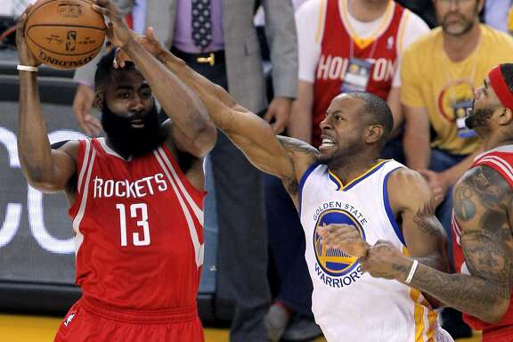 Andre Iguodala (9) defends against James Harden (13) in the first half as the Golden State Warriors played the Houston Rockets in game 2 of the first round of the Western Conference Playoffs at Oracle Arena in Oakland, Calif., on Monday, April 18, 2016.