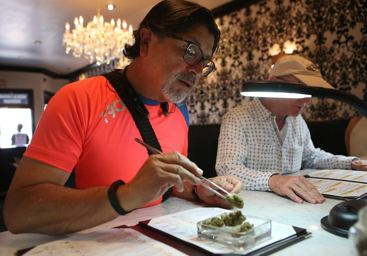 Francisco Kidd inspects and approves a selection of marijuana at Apothecarium on Monday April 18, 2016.