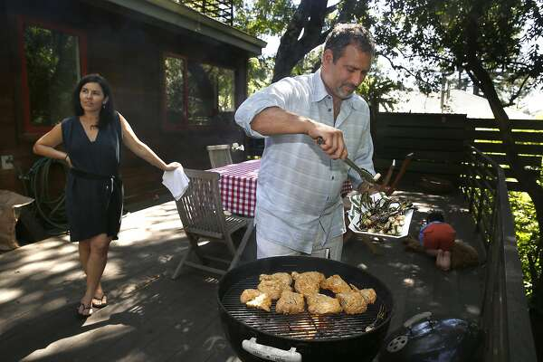 Chef Will Gioia grills chicken with his wife Karen Gioia (left) at home in Mill Valley, California on monday, april 18, 2016.