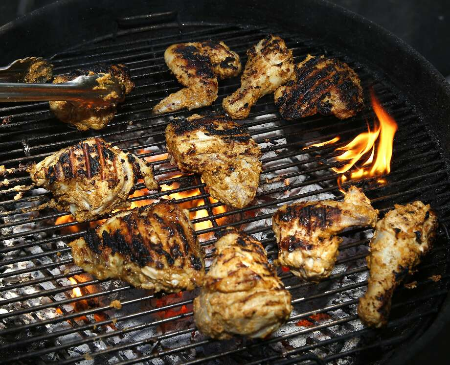Chicken on the grill at the Gioia home. Photo: Liz Hafalia, The Chronicle