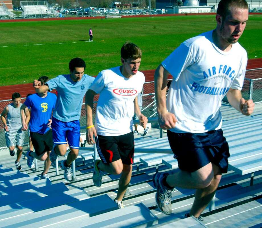 SPECTRUM/Kevin Eherts shows the way for John Rettenmeier, Wesley Marchena and other teammates during a pre-season drill for New Milford High School boys' track, April 1, 2010 Photo: Norm Cummings / The News-Times