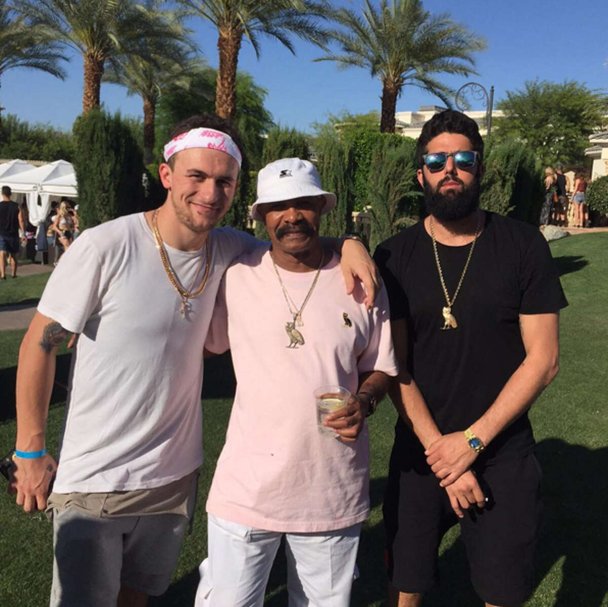 Johnny Manziel poses for a photo with Drake's father Dennis Graham and Ryan Silverstein at Coachella.