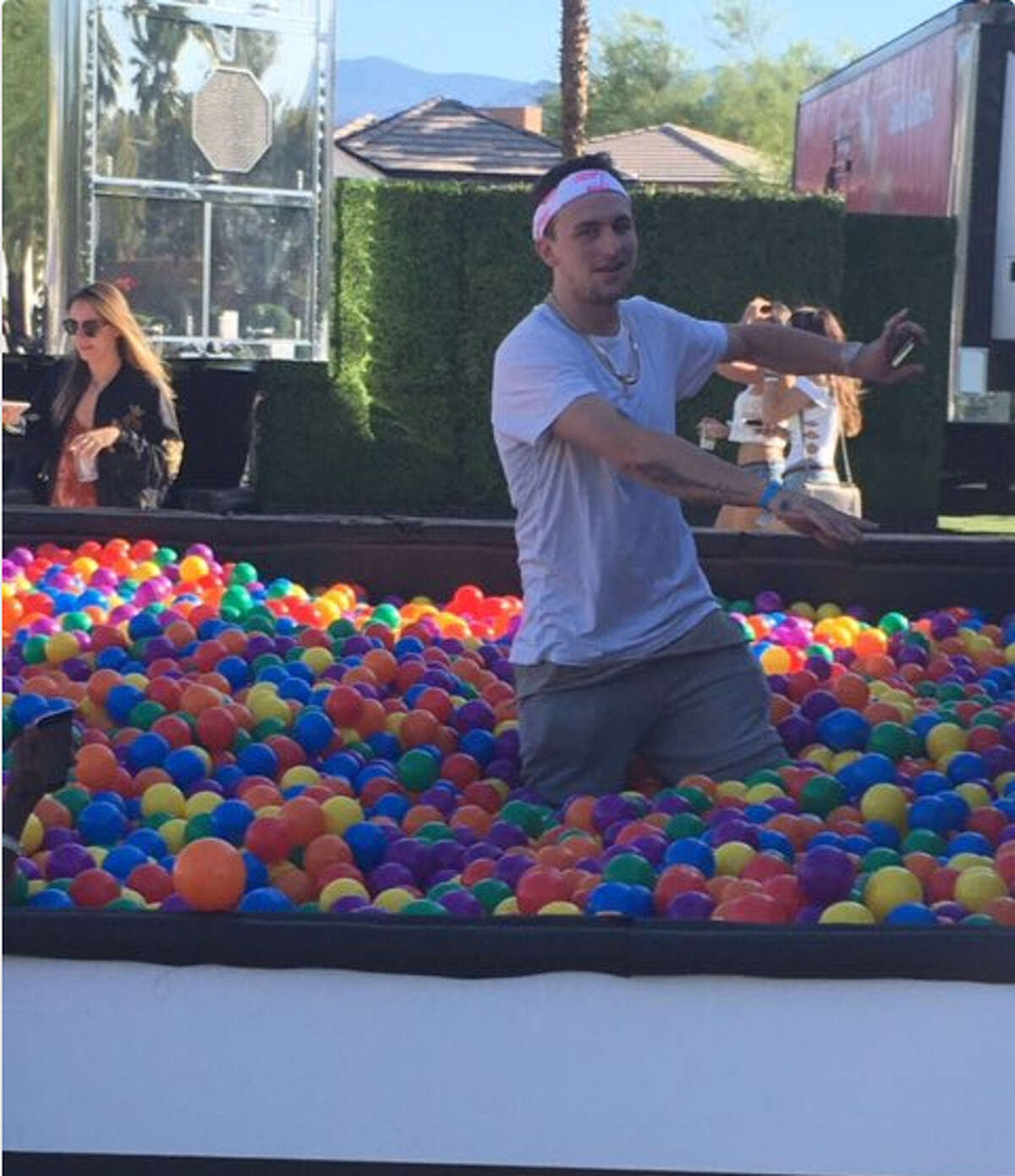Johnny Manziel dances in a ball pit at Coachella over the weekend.