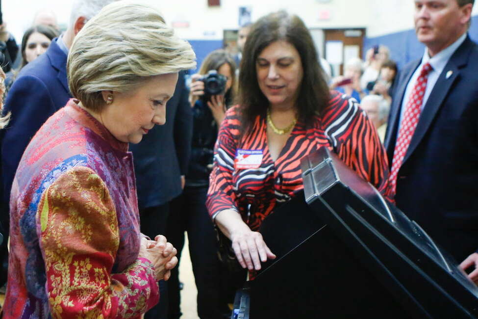 Democratic presidential candidate Hillary Clinton casts her ballot at a polling station during the New York State presidential primaries on April 19, 2016 in Chappaqua, New York. / AFP PHOTO / EDUARDO MUNOZ ALVAREZEDUARDO MUNOZ ALVAREZ/AFP/Getty Images ORG XMIT: New York