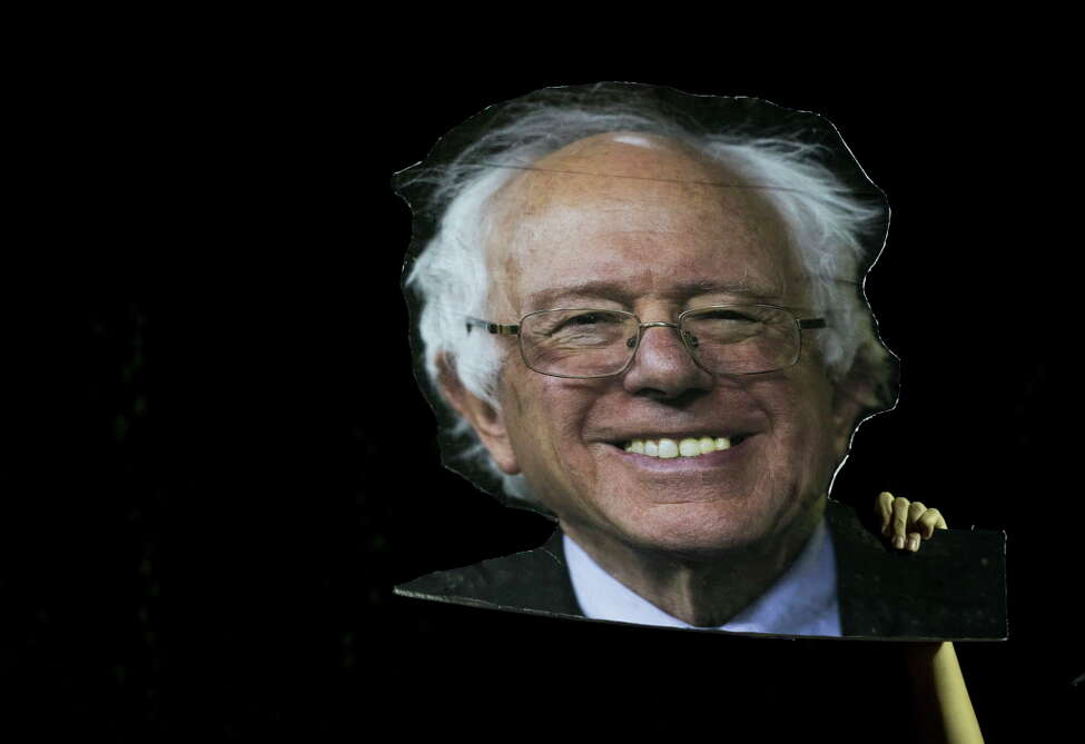A supporter holds up a cardboard cut out of Democratic presidential candidate Bernie Sanders, I-Vt., while he speaks during a campaign rally at Hunters Point park, Monday, April 18, 2016, in the Queens borough of New York. (AP Photo/Mary Altaffer) ORG XMIT: NYMA142