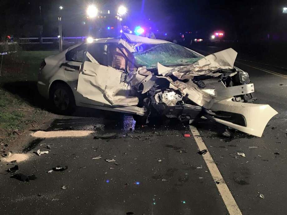 This picture, taken by an unknown person and provided by Newtown Police Department, shows what was left of the Honda Civic that was struck by a pickup truck on South Main Street Sunday night, killing its 90-year-old driver. Photo: Contributed