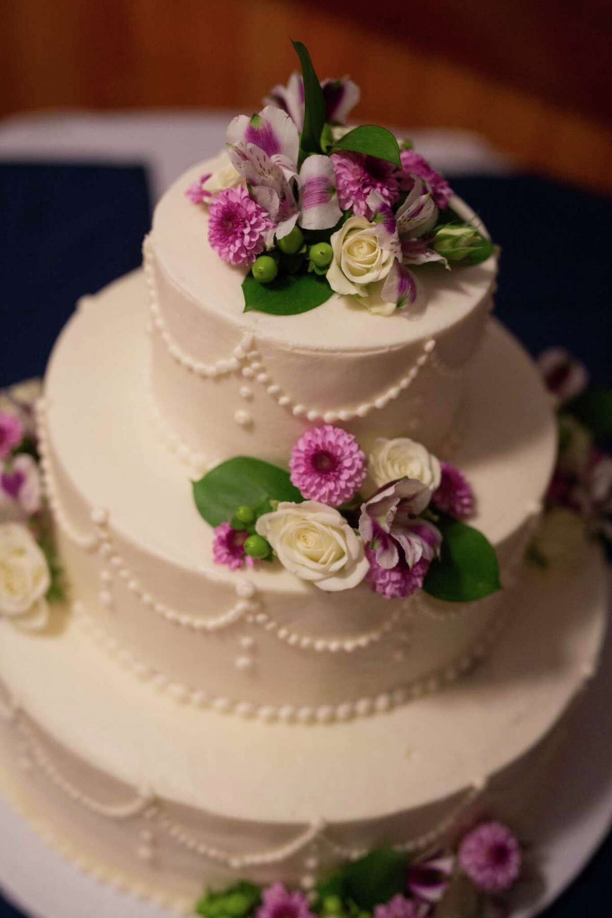 Detail of Cira Masters and Cory Carson wedding cake designed by Leah's Bakery in Round Lake at their September 12, 2015 nuptials. (Dave Bigler Photography)