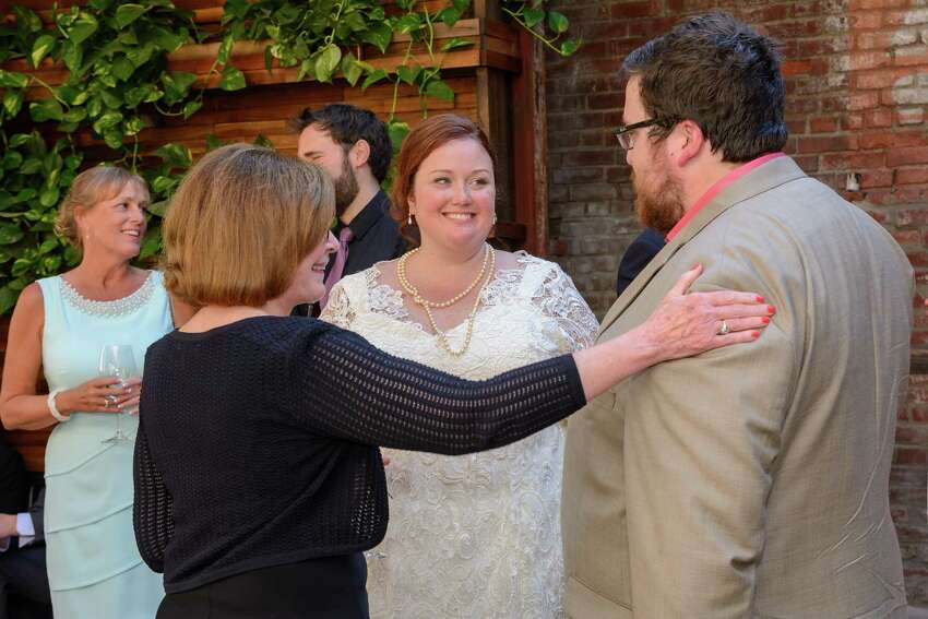 Brianna Snyder and David Deyette at their reception on September 27, 2014. (Trinacria Photography)