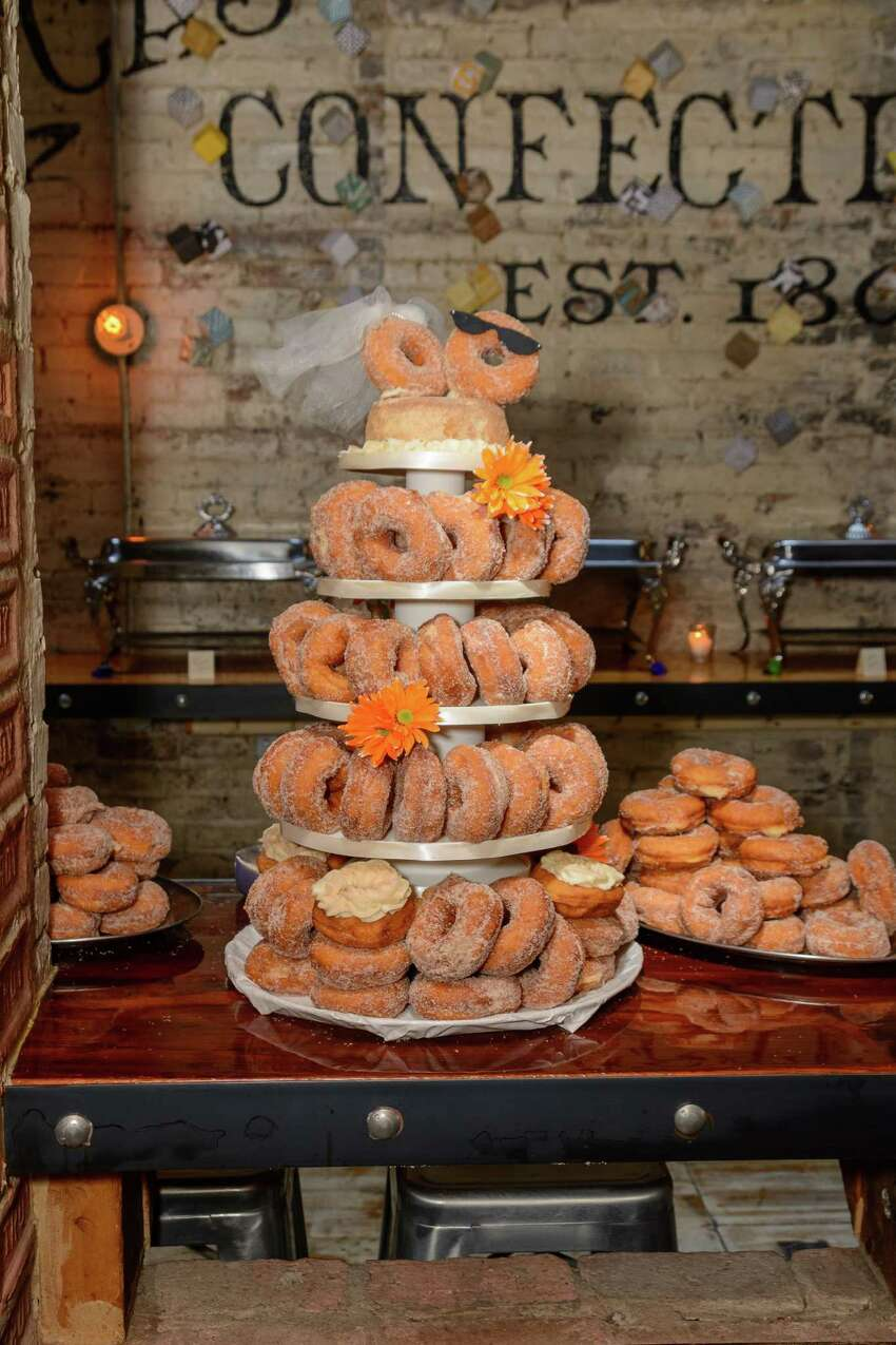 Brianna Snyder and David Deyette's creative Apple Cider Donut cake, made by a co-worker, at their reception on September 27, 2014. (Trinacria Photography)