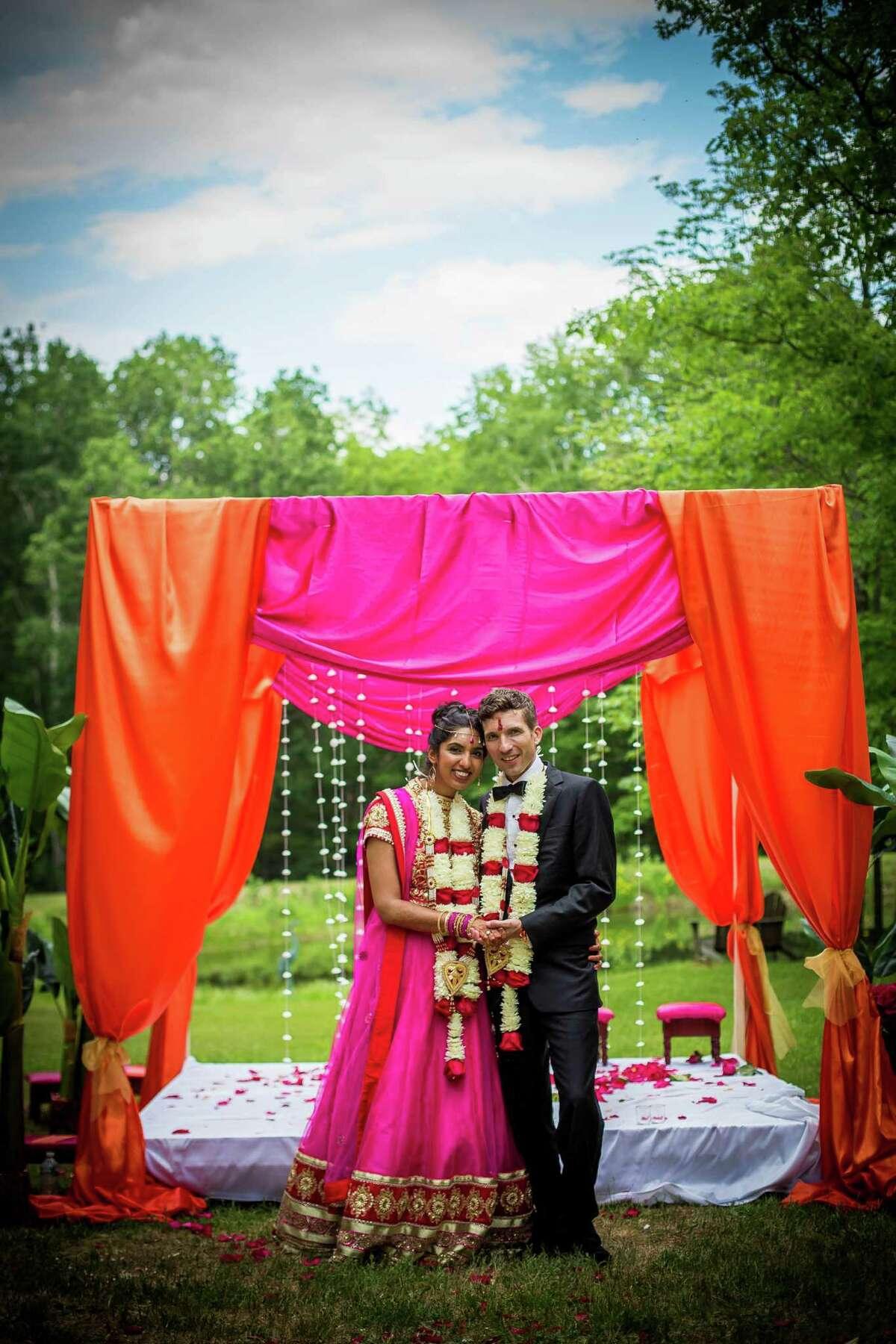 Puja and Daniel Post Senning pose at their May 30, 2015 nuptials. (Dexter Davis Photography)