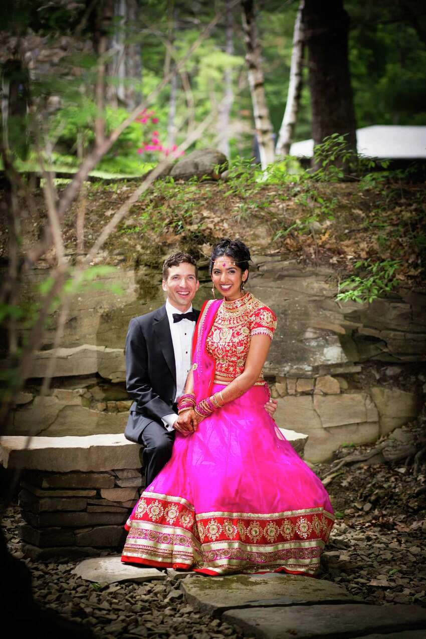 Puja and Daniel Post Senning pose oustide of Castle Breugnbach in Altamont at their May 30, 2015 nuptials. (Dexter Davis Photography)