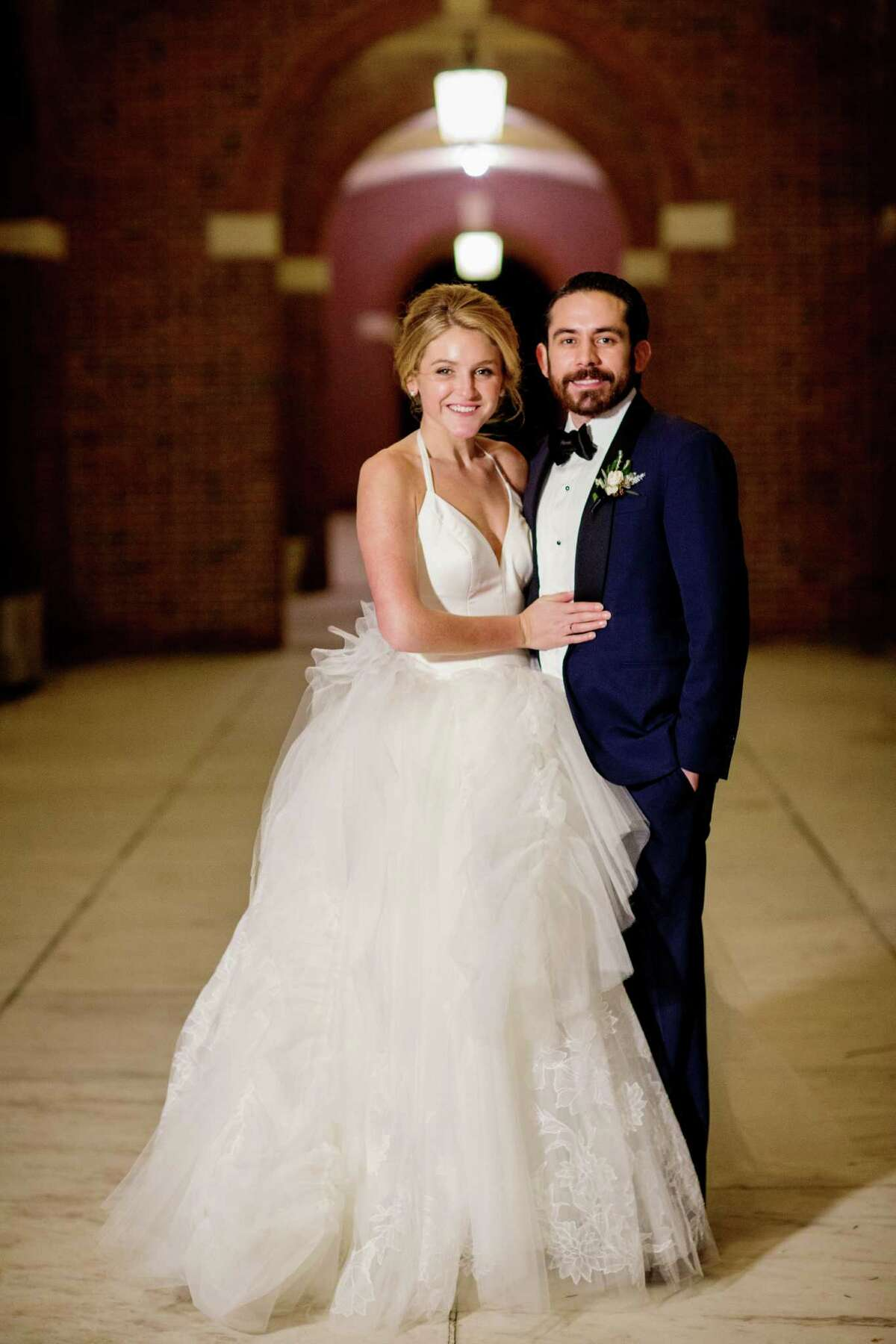 Brittany and Andrew Green pose, at the Hall of Springs in Saratoga Springs, during their January 16, 2016 nuptials. (Tracey Buyce Photography)