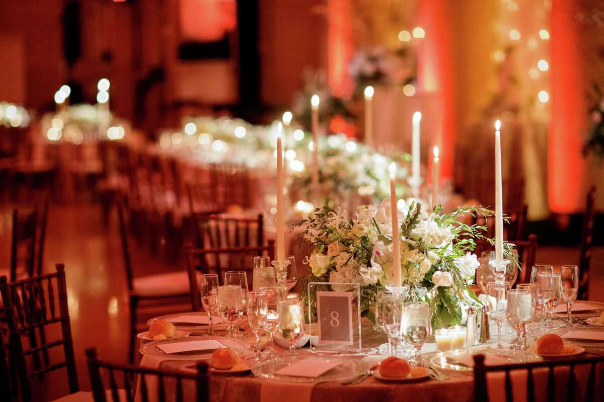 Detail shot of the table settings and flowers, designed by David at Renaissance Floral Design, at Brittany and Andrew Green at their January 16, 2016 nuptials. (Tracey Buyce Photography)