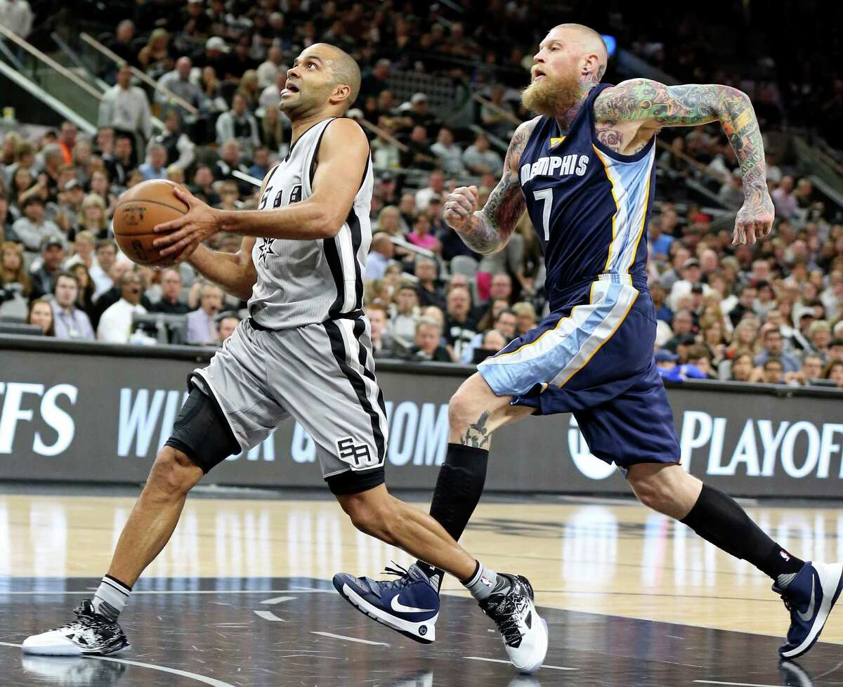 San Antonio Spurs' Tony Parker drives to the basket around Memphis Grizzlies' Chris Andersen during first half action of Game 1 in the first round of the Western Conference playoffs Sunday April 17, 2016 at the AT&T Center.