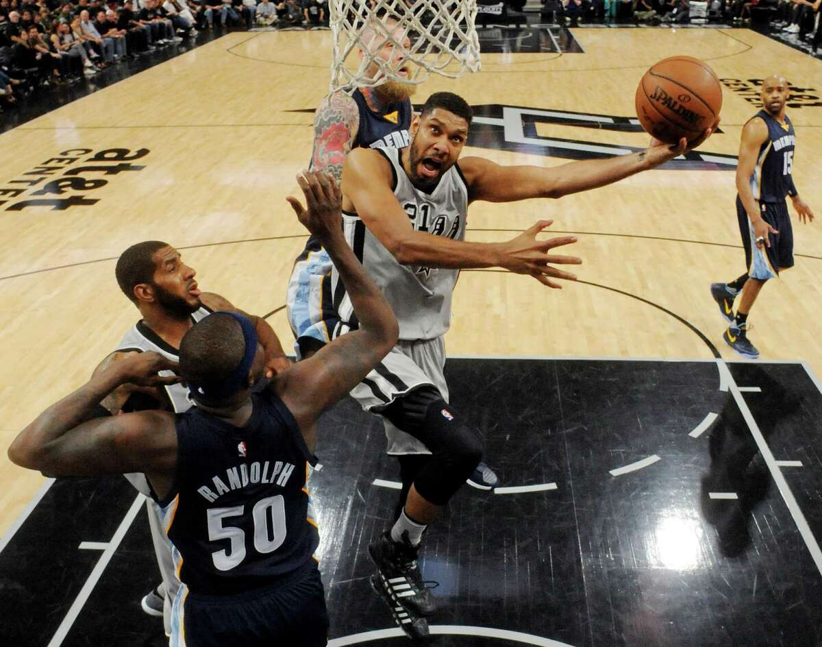 San Antonio Spurs' Tim Duncan shoots between Memphis Grizzlies' Zach Randolph (left) and Chris Andersen as San Antonio Spurs' LaMarcus Aldridge looks on during Game 1 in the first round of the Western Conference playoffs Sunday April 17, 2016 at the AT&T Center. The Spurs won 106-74.