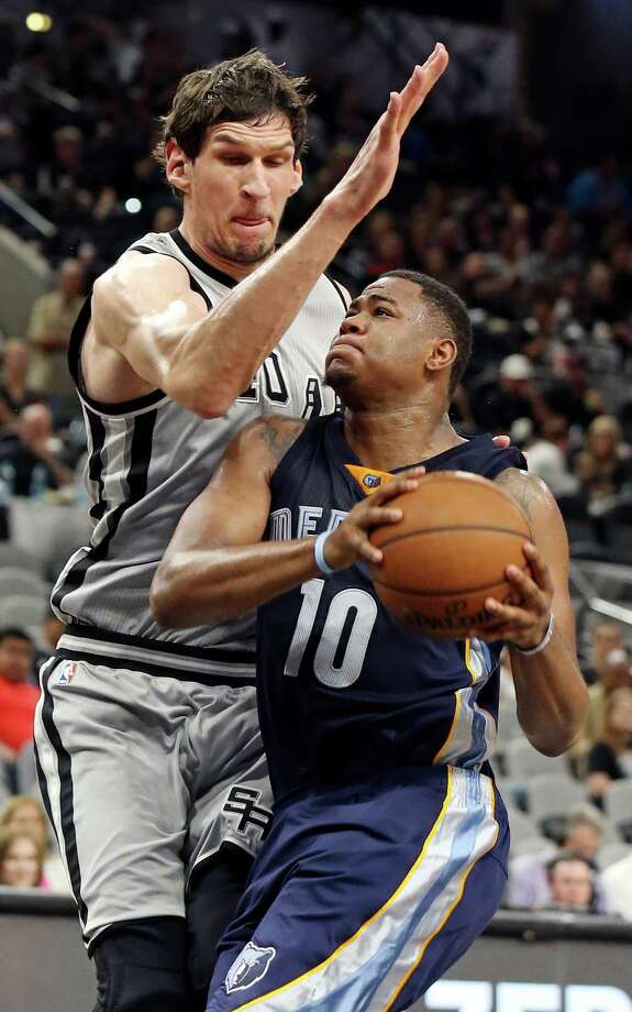 San Antonio Spurs' Boban Marjanovic defends Memphis Grizzlies' Jarell Martin during second half action of Game 1 in the first round of the Western Conference playoffs Sunday April 17, 2016 at the AT&T Center. The Spurs won 106-74. Photo: Edward A. Ornelas, Staff / San Antonio Express-News / © 2016 San Antonio Express-News