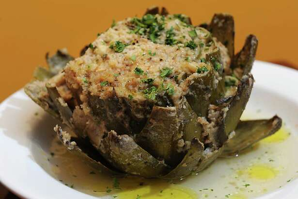 A fresh stuffed artichoke a la toto is an appetizer finished in a wood fired oven at Three Vines Bistro on Tuesday, Jan. 6, 2015 in Saratoga Springs, N.Y.  (Lori Van Buren / Times Union) ORG XMIT: MER2015010618321278