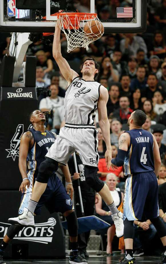 SAN ANTONIO, TX - APRIL 17: Boban Marjanovic #40 of the San Antonio Spurs dunks in front of Jordan Farmar #4 of the Memphis Grizzlies during Game One of the Western Conference Quarterfinals during the 2016 NBA Playoffs at AT&T Center on April 17, 2016 in San Antonio, Texas.  NOTE TO USER: User expressly acknowledges and agrees that by downloading and or using this photograph, User is consenting to the terms and conditions of the Getty Images License Agreement. Photo: Ronald Cortes, Getty Images / 2016 Getty Images