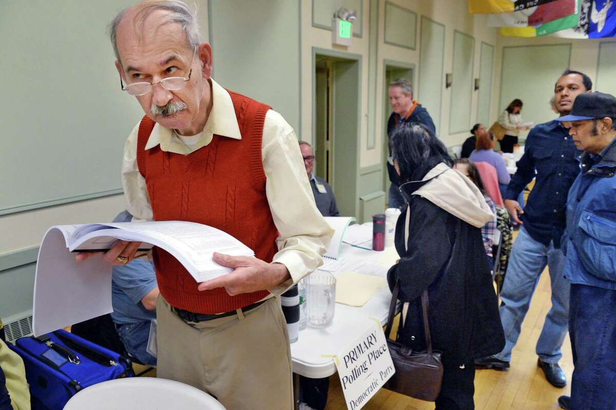 Long-time election inspector John Travis marvels at the turn out for the New York presidential primary at the Ancient Order of Hibernians Tuesday April 19, 2016 in Albany,NY. (John Carl D'Annibale / Times Union)