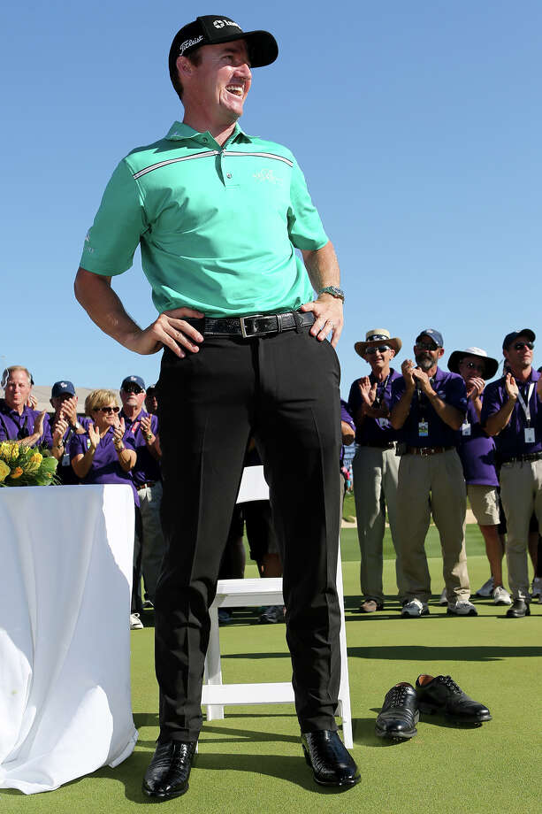 Boerne's Jimmy Walker shows off his championship boots after winning the 2015 Valero Texas Open at TPC San Antonio. Walker was 11 under for the tournament and will defend his title this year against some of the best golfers in the world.Click through to see some of the big names competing in the 2016 Valero Texas Open Photo: Marvin Pfeiffer /San Antonio Express-News / Express-News 2015