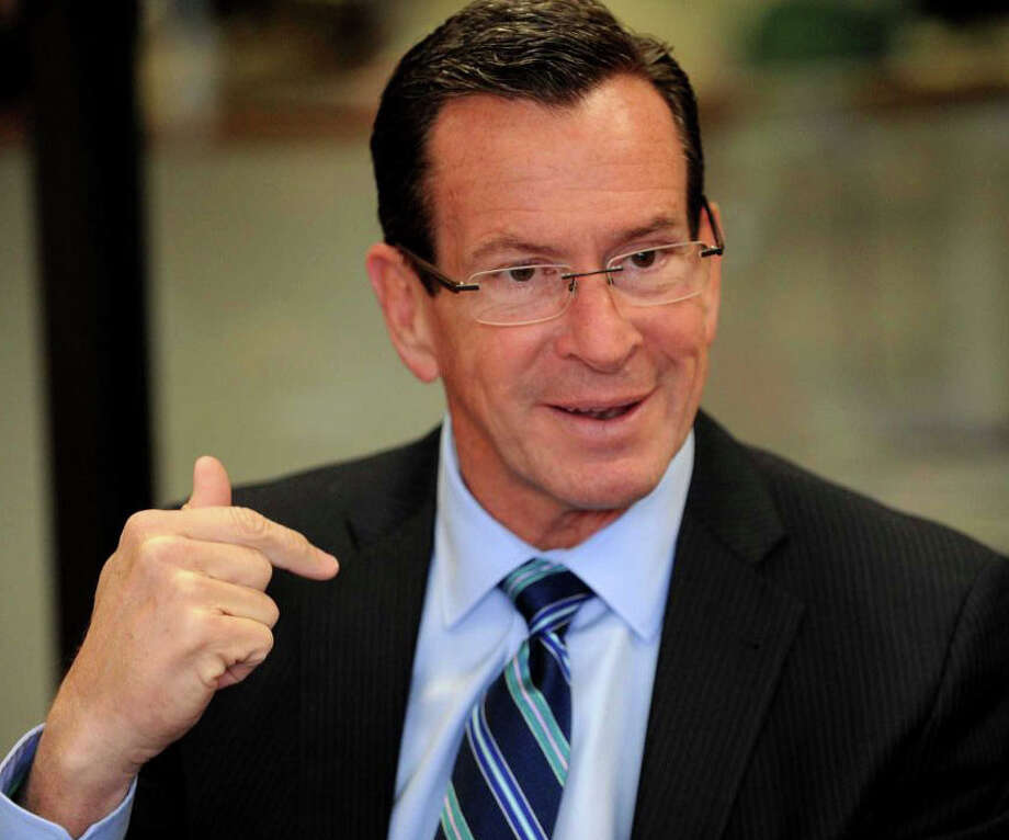 Gov. Dannel Malloy's latest proposal to address a state budget deficit would cut $922 million from the next fiscal year's spending. The proposal includes multi-million-dollar cuts in school aid to affluent towns in Southwestern Connecticut. Photo: File Photo / File Photo / Fairfield Citizen