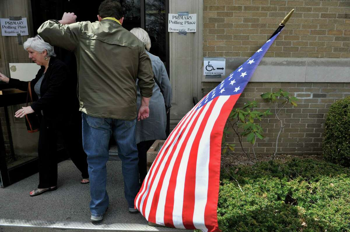 Voters make their way in and out of the Bethlehem Town Hall during voting on Tuesday, April 19, 2016, in Bethlehem, N.Y. (Paul Buckowski / Times Union)