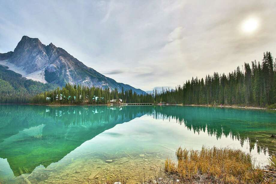 Emerald Lake, BC, CanadaEmerald Lake is in Yoho National Park, British Columbia, Canada. It is the largest of Yoho's 61 lakes and ponds, as well as one of the park's premier tourist attractions. Photo: Peter Unger, Getty Images / Lonely Planet Images