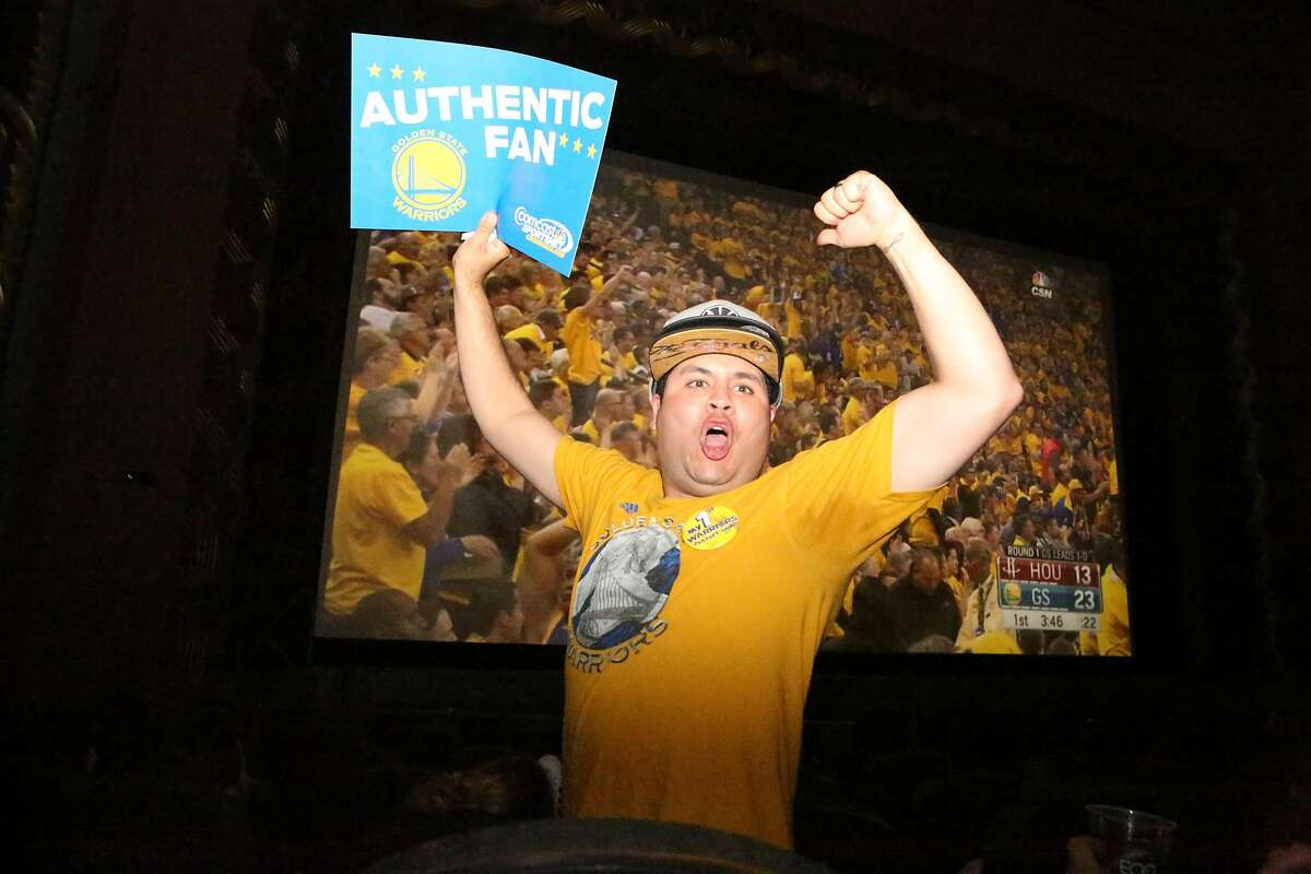 Super fan, Greg Vera, stands up to excite the crowd during the Warriors game at the Alameda Theatre on Monday, April 18, 2016.