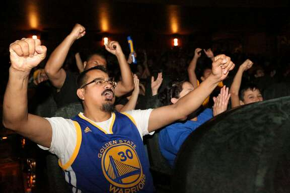 Warrior fan Moises Tapia from Alameda reacts to a close shot during the Warriors game at the Alameda Theatre on Monday, April 18, 2016.